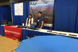 Montclair State Students staffing LIGO booth at NEAF