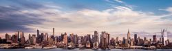 view of NYC skyline with blue sky and clouds