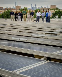 Green Team facility tour on roof with solar panels