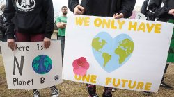 Signs at climate rally