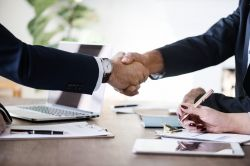 Picture of two business people shaking hands