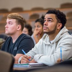 Image of a student sitting in a lecture class.