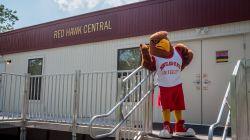 Rocky posing for a photo outside of Red Hawk Central.