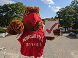 Rocky the Red Hawk with clip board and check mark