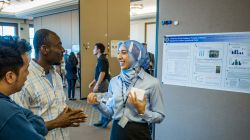 student discussing poster