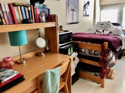 Another side of a double room in Blanton Hall with a bed and desk decorated by a student.