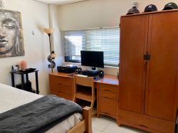 A desk and bed in a Single Room in Blanton Hall.