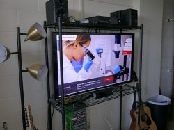 A television in a student's dorm room on the University's website.
