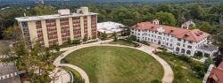 The exteriors of Freeman Hall and Russ Hall and the Quad from an aerial photo.