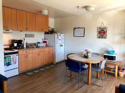 The kitchen area of a multi-floor Hawk Crossings unit.