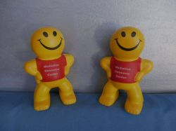 The Mediation Resource Center's mascot, a smiling yellow cartoon character.