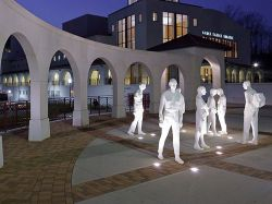 The People Statues outside of College Hall at night.