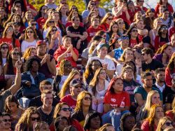 Photo of students in crowd at homecoming football game