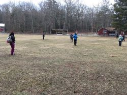 Students practice using a compass during the Orienteering class.