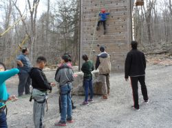 Students challenge themselves on the Climbing Wall.