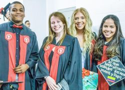 Image of students in cap and gown at a graduation ceremony.