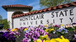 Exterior shot of main entrance and Montclair State sign.
