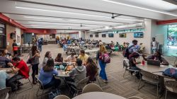 Inside of the Student Center cafeteria with students sitting at the tables