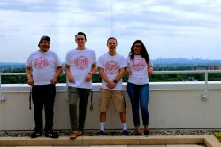 Members of the SGA Executive Branch standing with their backs to the New York City skyline.