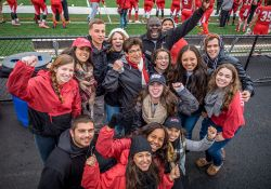 Group of students with Dr. Cole at Homecoming, cheering