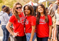 Three female students wearing red on a sunny day