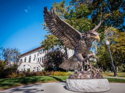 Front photograph of the Hawk Statue outside of College Hall.