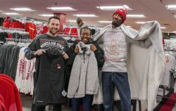 Montclair State students bundle up with some of the winter-warm options on sale at the University Bookstore November 14 and 15.