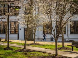 A student walking by Morehead Hall in the spring.