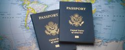 Picture of two U.S. Passports on a map of the world.