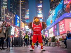 Rocky standing in the middle of Times Square posing for a picture.
