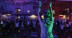 Picture of students in the dark glow doing yoga.