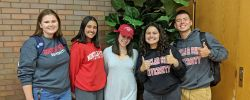 Five students wearing Montclair State gear!
