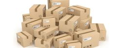 Graphic of a pile of brown boxes with delivery labels.