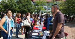 Students discussing Student Organizations in the Student Center Quad.