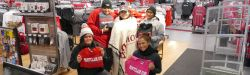 Picture of bookstore staff all bundled up in warm Montclair State gear!
