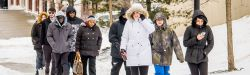 Picture of a group of Montclair State student bundled up walking on our snow-covered campus.