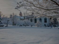 Snow covered campus and college hall