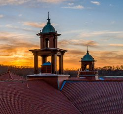 College Hall bell towers with sunset behind