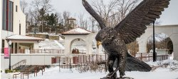 Red Hawk Statue on campus with snow.