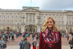 Student posing for portrait outside Buckingham palace
