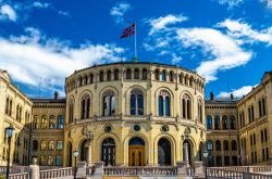 The Storting building, the Norwegian parliament in Oslo with flag.