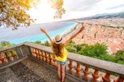 Photo of woman enjoying great view on the Nice city in France.