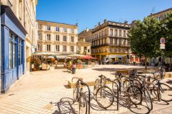 Photo of view on the small square with bicycles in Bordeaux city in France