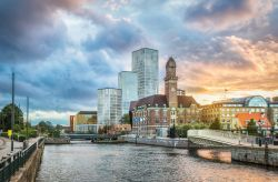 Beautiful cityscape with sunset over canal and skyline in Malmo, Sweden