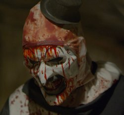 Screen capture showing mutilated clown character from: Terrified, a film in the horror genre