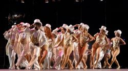 Large group of students performing in A Chorus Line
