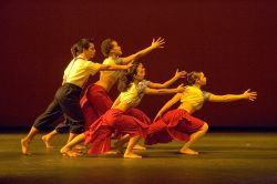Photo of five dancers leaning dramaticall toward something out of frame.