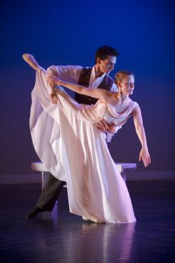 Photo of male and female dancers in flowing clothes.