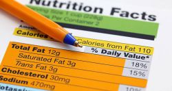 A pen over a Nutritional Information label.