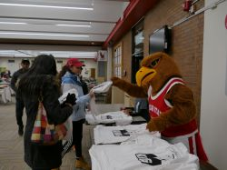 Rocky handing out some t-shirts at the MLK Day of Service.
